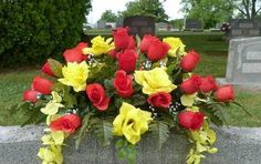 Beautiful headstone spray made of artificial silk flowers.