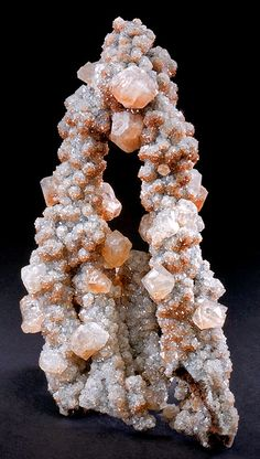 Hematite accented Calcite crystals on pillars of Calcite drusy