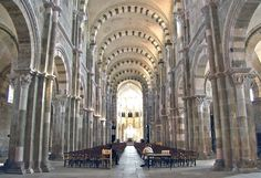VEZELAY ABBEY, France: today consists only of a church. The original abbey, based on the Benedictine rule of peaceful prayer & work, was founded, as many abbeys were, on land that had been a late Roman villa.  The name Vézelay comes from the name of the villa, Vercellus. The current nave, which had burnt once, with great loss of life, burned again in 1165, after which it was rebuilt in its present form.