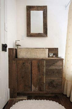 Weathered wood vanity w/ stone sink