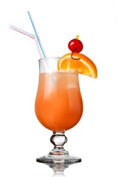 Orange-pink cocktail with an orange and cherry garnish