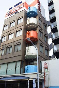 Coffee cup shaped balcony.