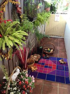 This small outdoor space has several sections with inviting stations for children to explore. - Puzzles Family Day Care Environment. For more inspiring spaces: http://pinterest.com/kinderooacademy/provocations-inspiring-classrooms/ ≈ ≈