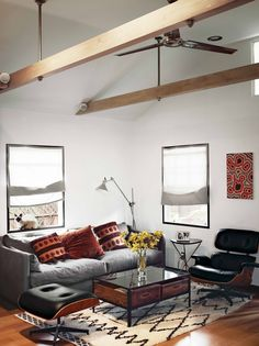 Love the Eames chair divided across a coffee table