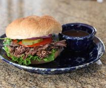 Crockpot Italian Beef Recipe - Super easy, feeds a crowd and EVERYONE loved it! We put it on a hoagie roll with provolone on top and stuck it under the broiler to make it all melty!