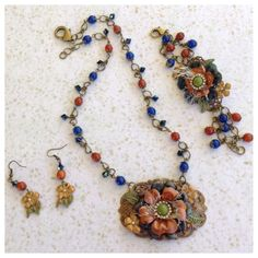 Sept. Parures Challenge Set and FUF .. Fall Is In The Air .. Both Necklace and Bracelet are made with B'sue Brass Stampings, Flowers (the small flowers I received in a big mama muse last year) and Leaves, Glass Beads, Crystals, Flat Back Pearls and Rhinestones, a touch of yarn in the middle of the flower was also used. Alcohol Inks and Gilders Paste used for the coloring ..  Designed By .. Jann Tague .. Clever Designs .. https://www.facebook.com/JewelsByJann
