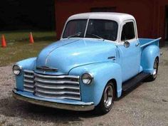 1951 blue and white Chevrolet 3 door pickup truck