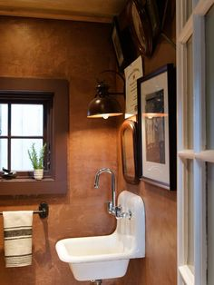 Forget all your stiff misconceptions about plaster. The old-house wall covering can shine with the best, like in this farmhouse powder room addition with gritty rustic shimmer. | Photo: John Gruen