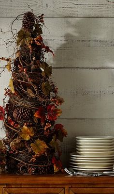 Twiggy Autumn Buffet Tree...with pine cones and leaves.