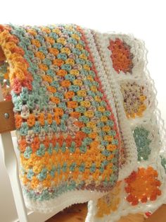 Two crocheted doll blankets