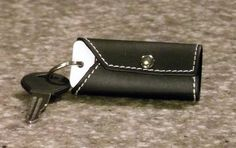 Black Leather TagWrap with White Stitching.  $8.99. Organize all your plastic keytags, loyalty cards, and store ID tags.  www.tagwrap.com