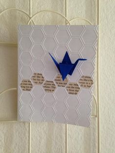 handmade card ... If books were wishes... by justheather  ... honeycomb embossing folder texture .. row of book page hexagon fill ... royal blue origami crane ... simple and intriguing ...