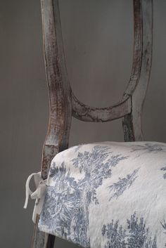 One coat of acrylic primer   sand it down again (using very fine sand paper)   a coat of grey furniture wax (rub it on and buff it out)   and a new toile de jouy fabric    Just a day's work and voila!!   ....so pretty again