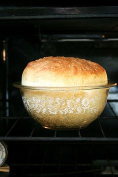 Mother's Peasant Bread: The Best Easiest Bread You Will Ever Make!  It's a no-knead bread. It bakes in well-buttered pyrex bowls and it emerges golden and crisp. It's spongy and moist with a most-delectable buttery crust #butter #bread #peasant_bread #recipes
