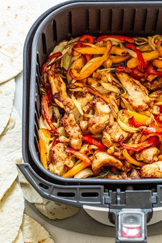 Who knew you could use the air fryer to make chicken fajitas for dinner? All you have to do is combine sliced chicken, peppers and onions with fajita seasoning in the tray.