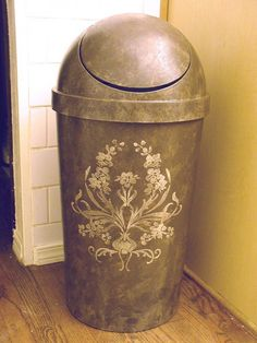Wow!  I would leave my trash can in the living room!  How amazingly cool is this!  Make A Plastic Garbage Can Look High End - by VIctoria Larsen Stencils