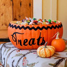 Cut off the top of an artificial pumpkin to make this one-of-a-kind Halloween treat bowl. More quick Halloween decorations: http://www.bhg.com/halloween/crafts/frightfully-frugal/?socsrc=bhgpin102912pumpkinbowl#page=14