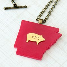 Arkansas Razorbacks resin necklace with hand stamped brass pig, WPS. $35.00, via Etsy.... love this!