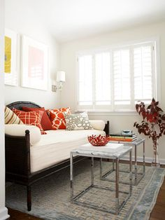 Bright pops of pumpkin orange in an subdued room bring in the season.