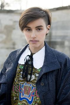 long in front with shaved side hairstyle