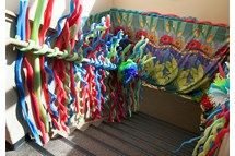 Stairwell wrapped with pool noddles. FUN!