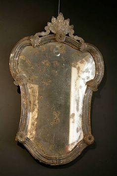 Love this old Venetian mirror.