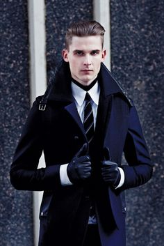 Yves Saint Laurent wool and leather blazer, wool vest, cotton shirt and wool and leather pants. Dior Homme cotton turtleneck. Kris Van Assche tie. Jil Sander gloves