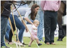 Full time job: The Duchess of Cambridge was kept busy attempting to hang on to Prince George who was much more interested in stomping about and doing his own thing