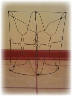 Upcycled Wire Hanger Edging Fence -