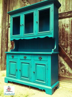 painted it using Valspar's Vintage Teal in satin.  After I painted it (which took almost an entire gallon!! I glazed it using Ebony stain by Minwax. I used all of the original hardware and spray painted it with primer and then painted it using a Rustoleum black spray paint. The finished product was simply breath taking….one more time, shall we?