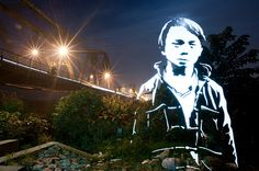 Using long-exposure photos made with lights shone through large cut stencils, Wittner Fabrice creates figures of light in different cityscapes. He coins them 'enlightened souls', and has so far experimented with this art form in Vietnam and post-earthquake Christchurch, New Zealand