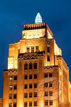 Wisconsin Gas Building at evening (note the famous blue flame). Milwaukee. Wisconsin  UWM gave deco a bit more respect.  I did a term paper on this building.  The flame changed color to communicate the weather forecast.