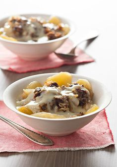 Slow-Cooker Apple Crisp with Warm Vanilla Sauce -- Fresh apples and tart cranberries do a long, slow simmer with a few unexpected ingredients. And the results of this dessert recipe? Downright delicious.