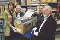 jesikah maria ross, far left, Shipley Walters, Analu Josephides and Supervisor Don Saylor stand by a stack of historical records being resubmitted to the Yolo County Archives in Woodland on Wednesday.