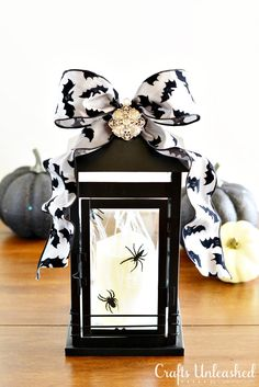 Halloween Decor Lantern: Spooky Glam Lantern with Spiders. Great way to decorate the outside of the house.
