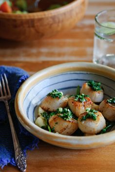 A bowl of seared scallops.