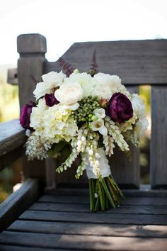 A gorgeous rustic wedding bouquet with interesting textures and loose stems.