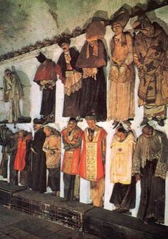 In the catacombs beneath the Capuchin monastery of Palermo, Sicily, fully clothed cadavers may be found propped upright or hanging from the walls. These are friars, priests, and other clergymen.