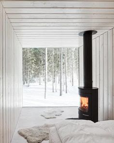 White Cabin Interior - one of my mini cabins would be all white with this cool black fireplace