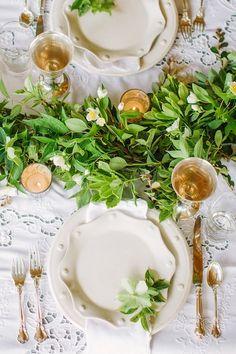 Green garland and white china