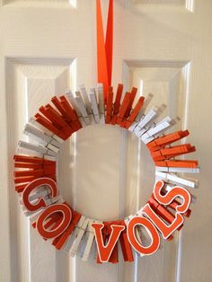 Adorable University of Tennessee 'Go Vols' door hanger wreath made out of clothespins. A really cute way to show off your team spirit! Will take custom order requests for this and other sports teams through Etsy store.