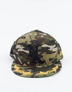 Mark McNairy x @New Era woodland camo with a golden wreath on the brim. $78.00