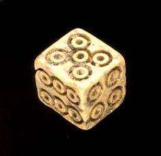 Ivory or wooden? old die / dice