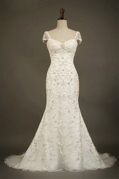 Custom Sweetheart Lace Tulle Wedding dress. Want to see if I can have my wedding dress taken in like this shape.