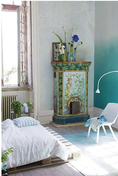 I like the old, painted stove and the ombré wall. The bed on a palate cracks me up. Thanks, Pinterest. Is there just an excess of palates out there? I don't know if the factory workers and the Pinterest soccer moms really connect that often.