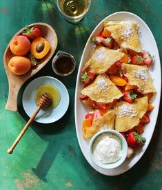 Use hazelnuts, honey whipped cream and peaches to make these crepes.