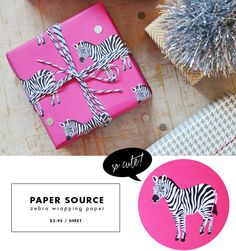 I don't care what holiday it is, zebra wrapping paper with black and white bakers twine is divine.