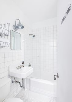 Industrial Utilitarian bath with Matte Arctic white tiles (Daltile), penny tiles, stencil, reclaimed sink and galvanized sconce (http://www.barnlightelectric.com)