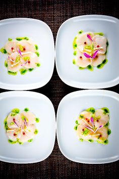 Scallop Crudo with Shiso & Yuzu Oils and Pink Peppercorn.