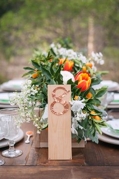 hammered copper table numbers, photo by Michael and Kate Photography http://ruffledblog.com/lake-hodges-wedding-inspiration #weddingideas #tablenumbers #metallic